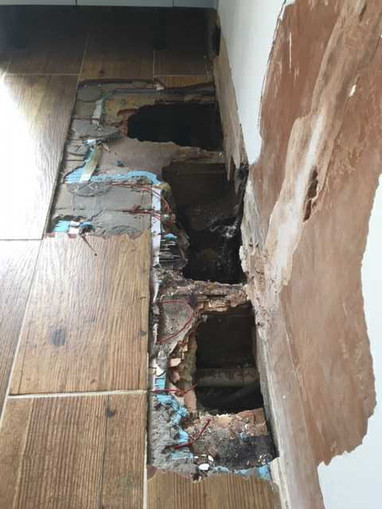 This mess was left by plumbers looking for a leak under a ceramic tiled floor ....