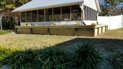 rain garden around pool house in summerv