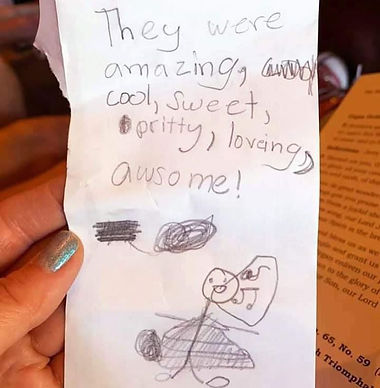"""Stick figure drawing of a singer, with elementary handwriting caption that says, """"They were amazing, cool, sweet, pritty, loveing, awsome!"""""""