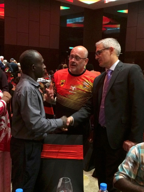 Chief Patrick from Kainake having a conversation with Professor Tim Flannery and an Australian Commission staff member