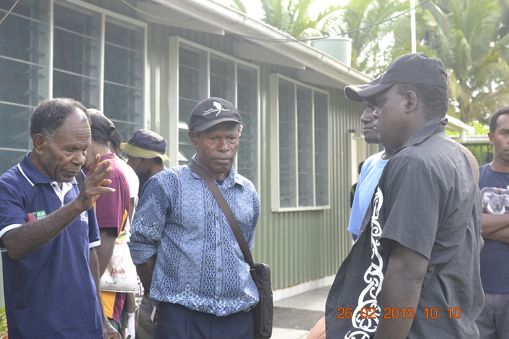 Community leaders from Lumi conversing with visiting team from Bougainville