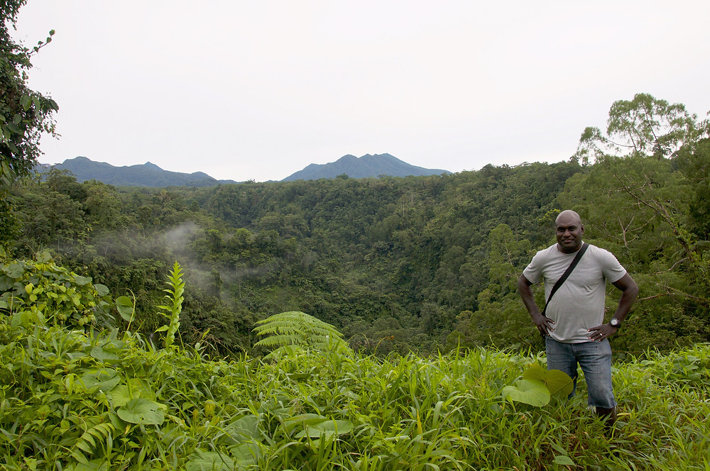 Dr Noro at the conservation site. In the background is Mt Takuan