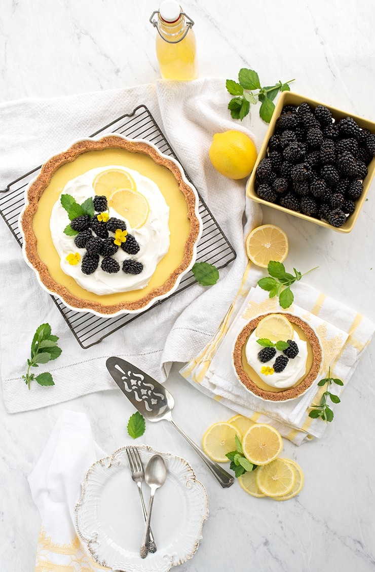 lemon icebox pie with lemons and berries