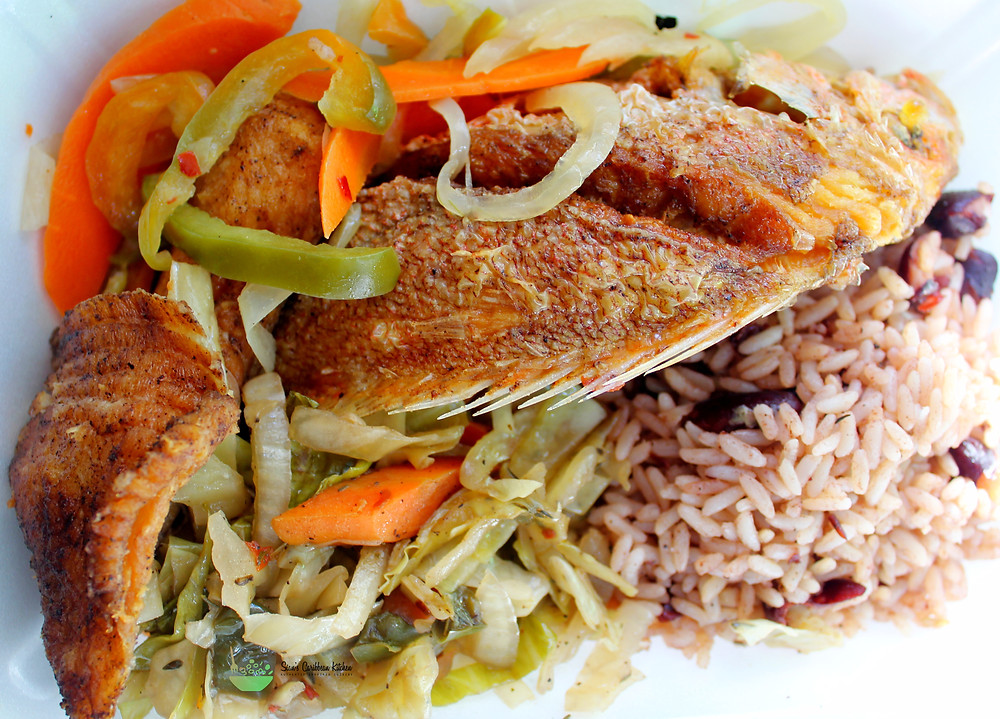 Escovitch fish with rice, beans, vegetables
