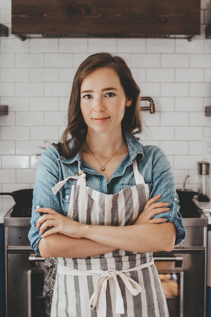 woman in apron with arms crossed