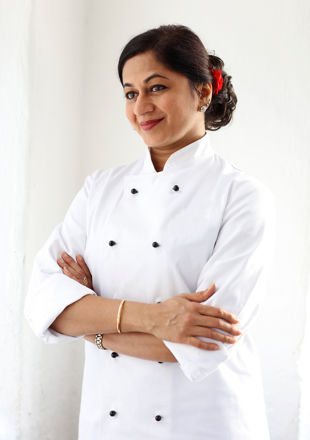 female chef standing with arms crossed