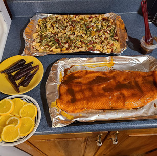 Potatoes and carrots from the garden. The salmon is covered with birch syrup