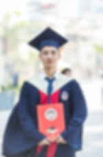 man-in-toga-holding-diploma-1007066.jpg