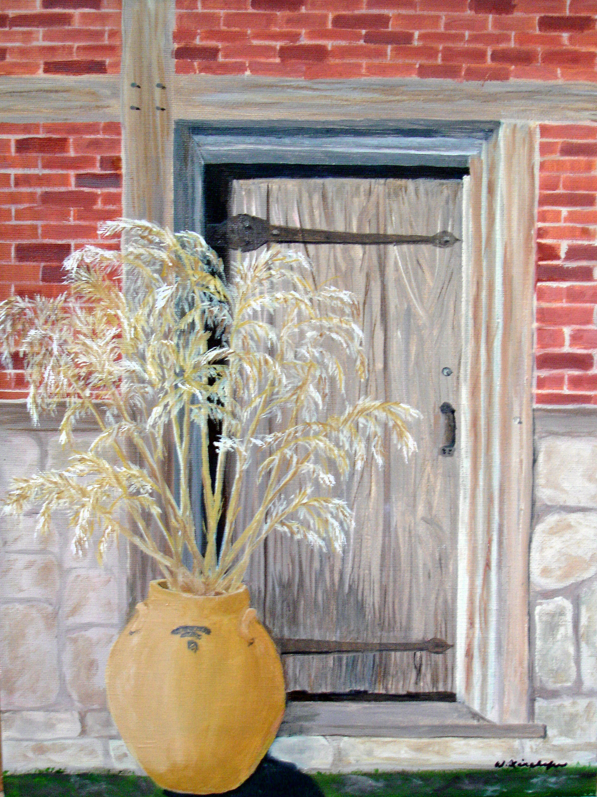 doorway with jug of grasses_edited