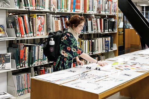 ArtCenter student at the 2020  Fogg Library Rebrand Launch Party and accompanying exhibit.