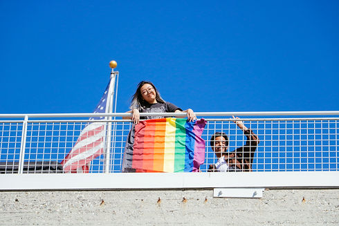 DEI Creativist Andrea Hu and friend smiling at the National Coming Out Day and Rainbow Flag Raising Ceremony held at ArtCenter South Campus Rooftop