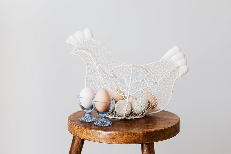 kaboompics_Hen - shaped egg basket & gla