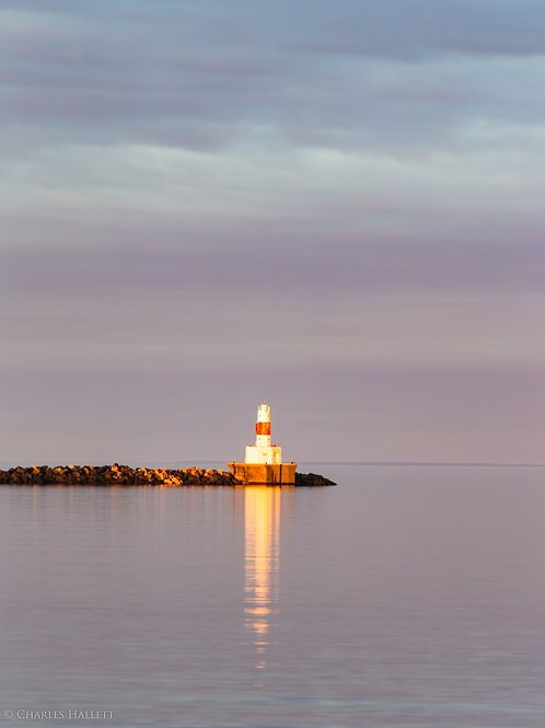 Lighthouse under a Soft Pink Sunset