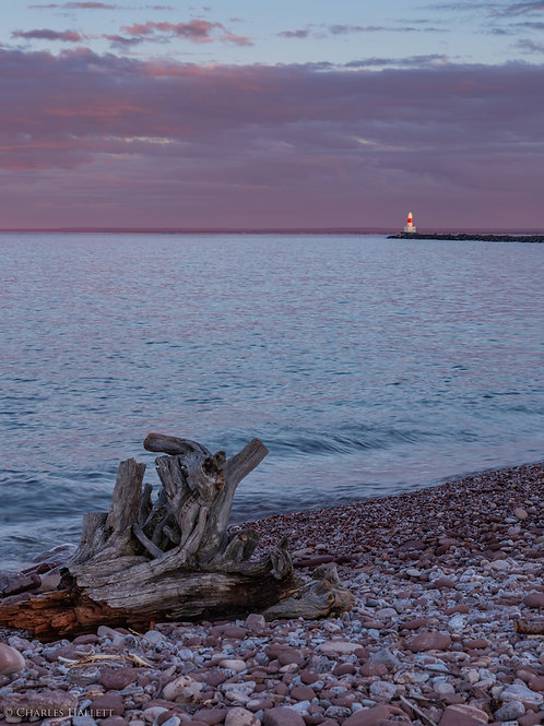Pink Lighthouse with Drift Wood Sunset