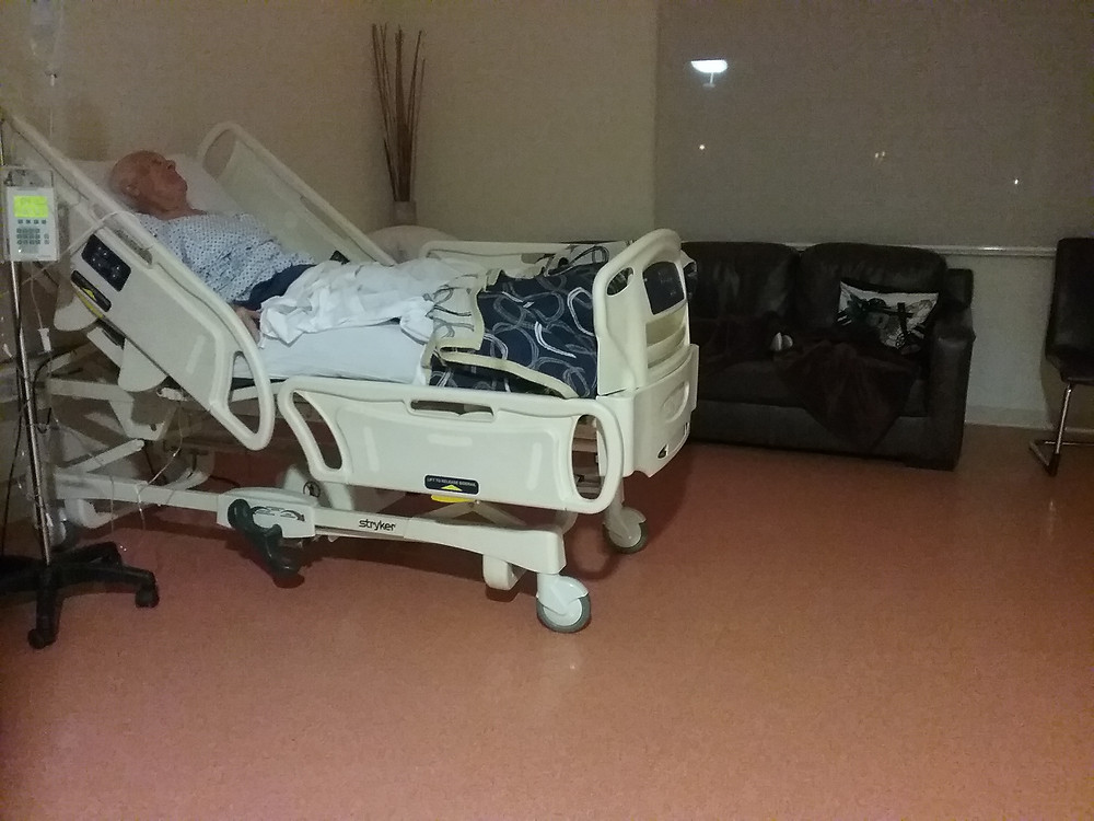 Large, private hospital room with couch and recliner