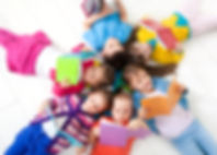 Group of children enjoying reading toget