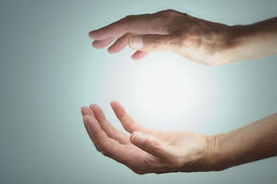 Hands-with-light-cropped-Edited.jpg