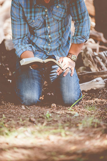 Man on knees with bible.jpg