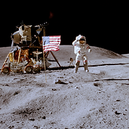 Astronaut planting US flag on the moon