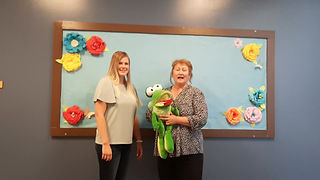 Kindergarten teachers welcome students to class