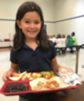 child with a lunch tray