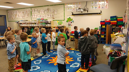 first and second grades saying the pledge of allegiance