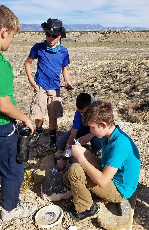 students working in the desert