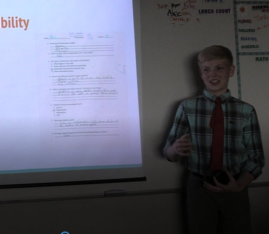 eight-grade student presenting his passage presentation