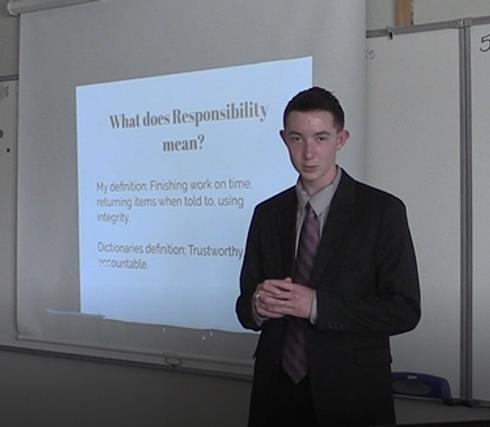 eighth-grade student presenting his passage presentation