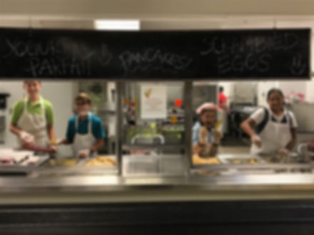 students serving lunch