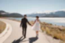 A bride and groom do their first look in silverthorne clorado. at lake dillion. modern sunnywedding