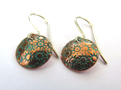 Copper circle dangles with green patinat