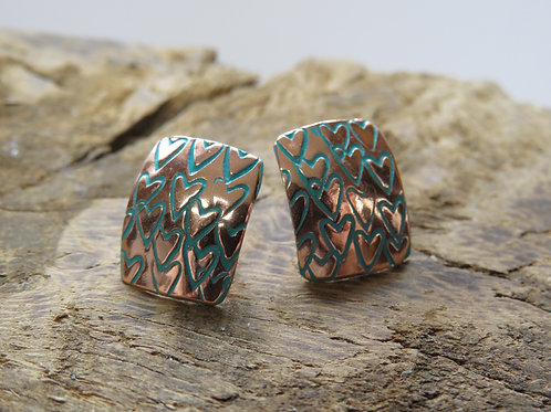 Heart stamped rectangle convex studs copper with green patina
