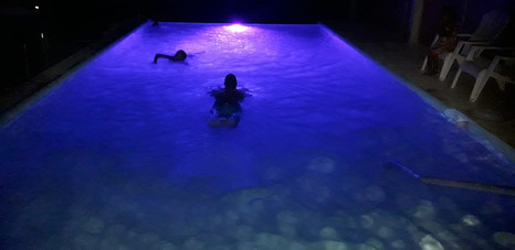 Enjoy a night swim in our See Belize Pool.jpeg