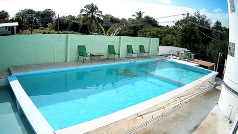 See Belize Pool with picnic table and deck chairs
