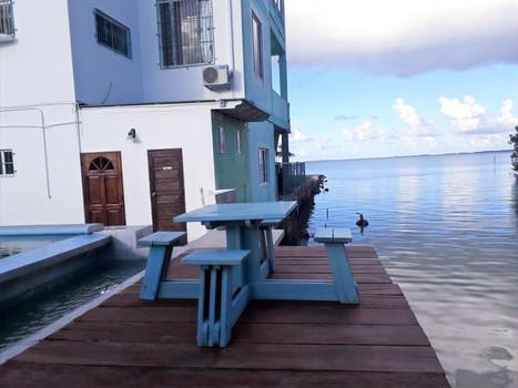 See Belize Overwater Deck overlooking the Caribbean Sea.jpg