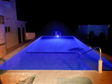 See Belize Pool at Night