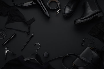 Black monochromatic flatlay on black bac