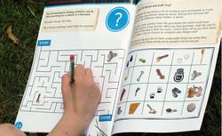 Child filling in Elsyng book