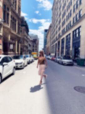 mid of street young women walking.jpeg