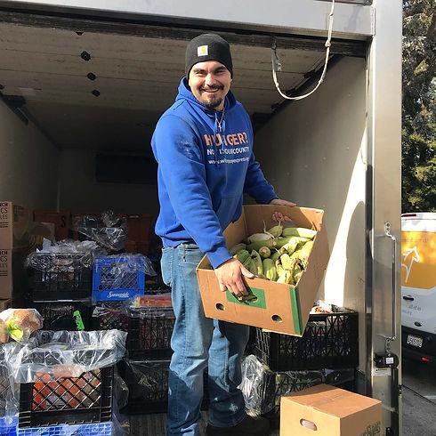 WPE employee Dario Guzman unloads a truck full of rescued food.JPG.jpg
