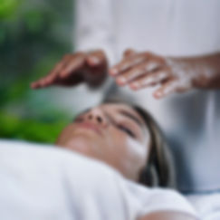 Square image of Reiki therapist holding