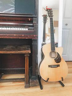 guitar, piano, and mirror in Rachel's home studio
