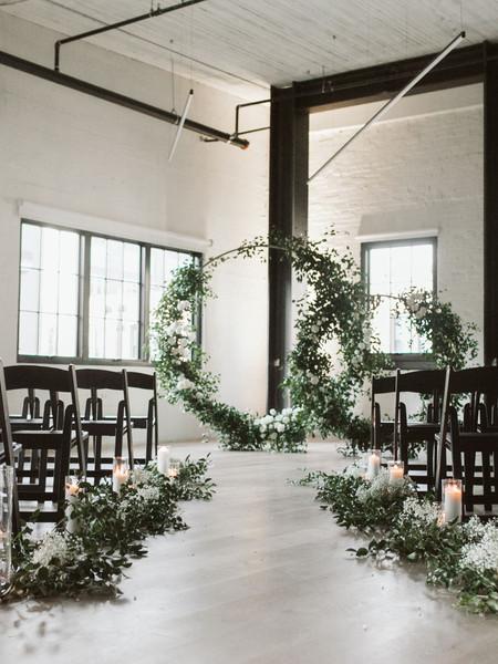 romantic wedding ceremony with elegant decor from Seattle wedding florist