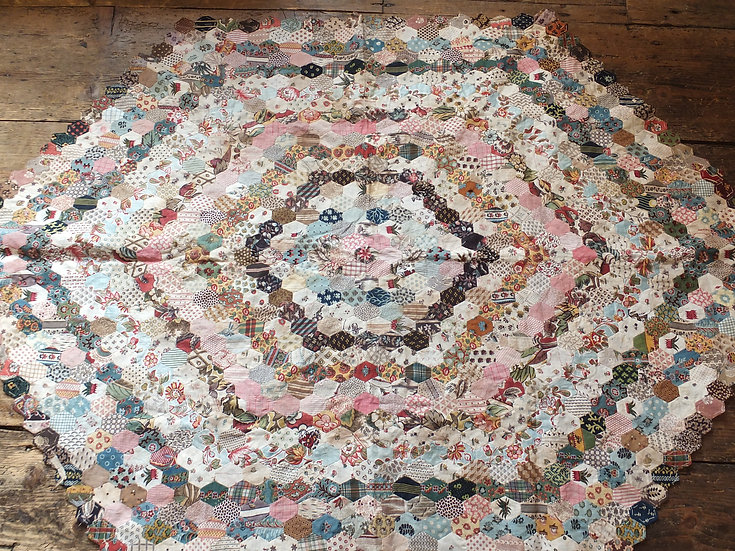 Early unfinished printed fabric patchwork quilt