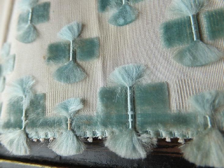 Velvet tufts on silk. The beauty of antique ribbon