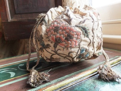 A Purse of 18th Century embroidery with fly braid tassels