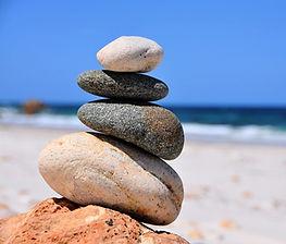 beach stacking rocks