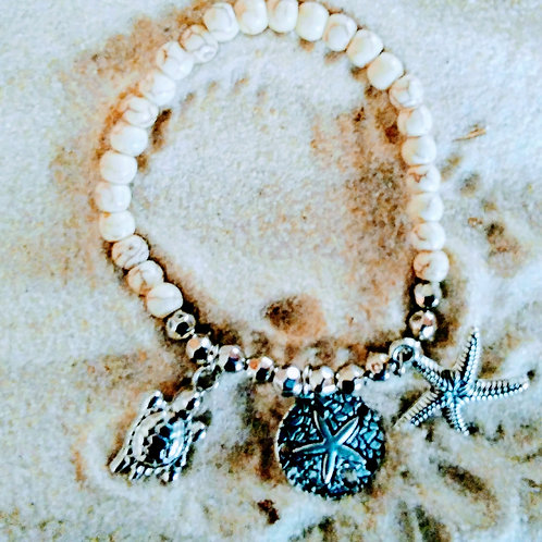 Beachy Ivory Colored Charm Bracelet