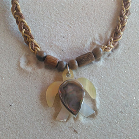 Shell turtle with braided cord necklace